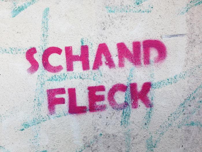 Wandtext Schandfleck