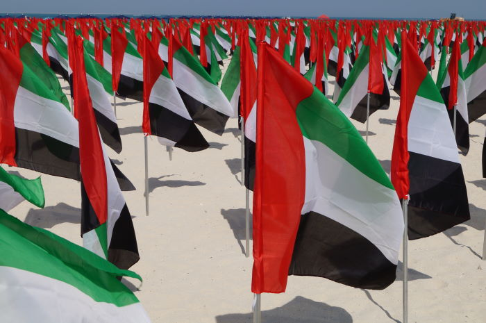 Dubai Flags on free public beach Jumeirah