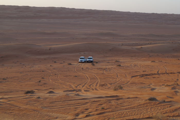 Oman, Nomadic Desert Camp Sunset Cars
